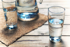 Glasses,Of,Water,On,A,Wooden,Table.,Selective,Focus.,Shallow